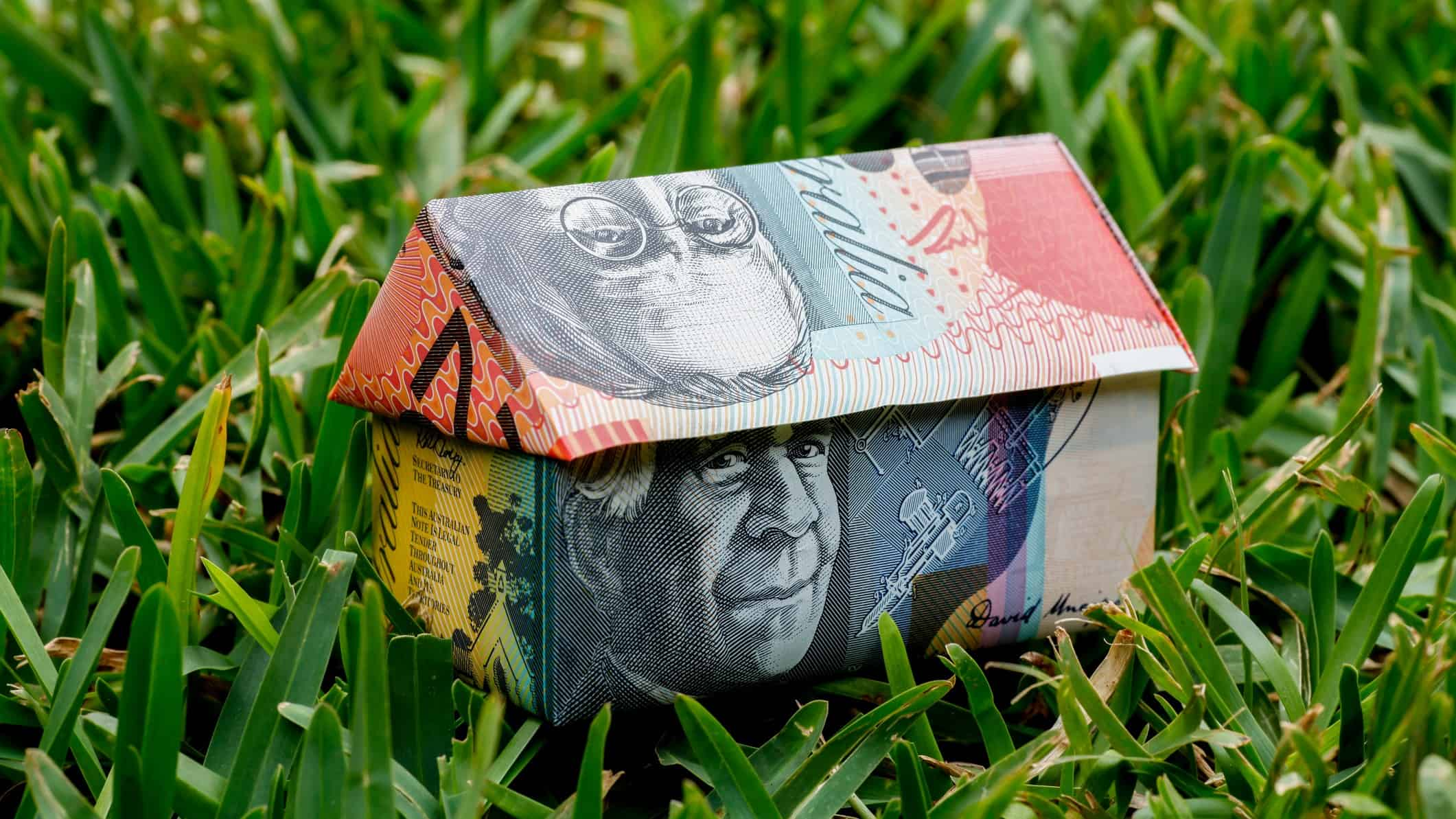 miniature building made from australian currency notes representing asx bank shares