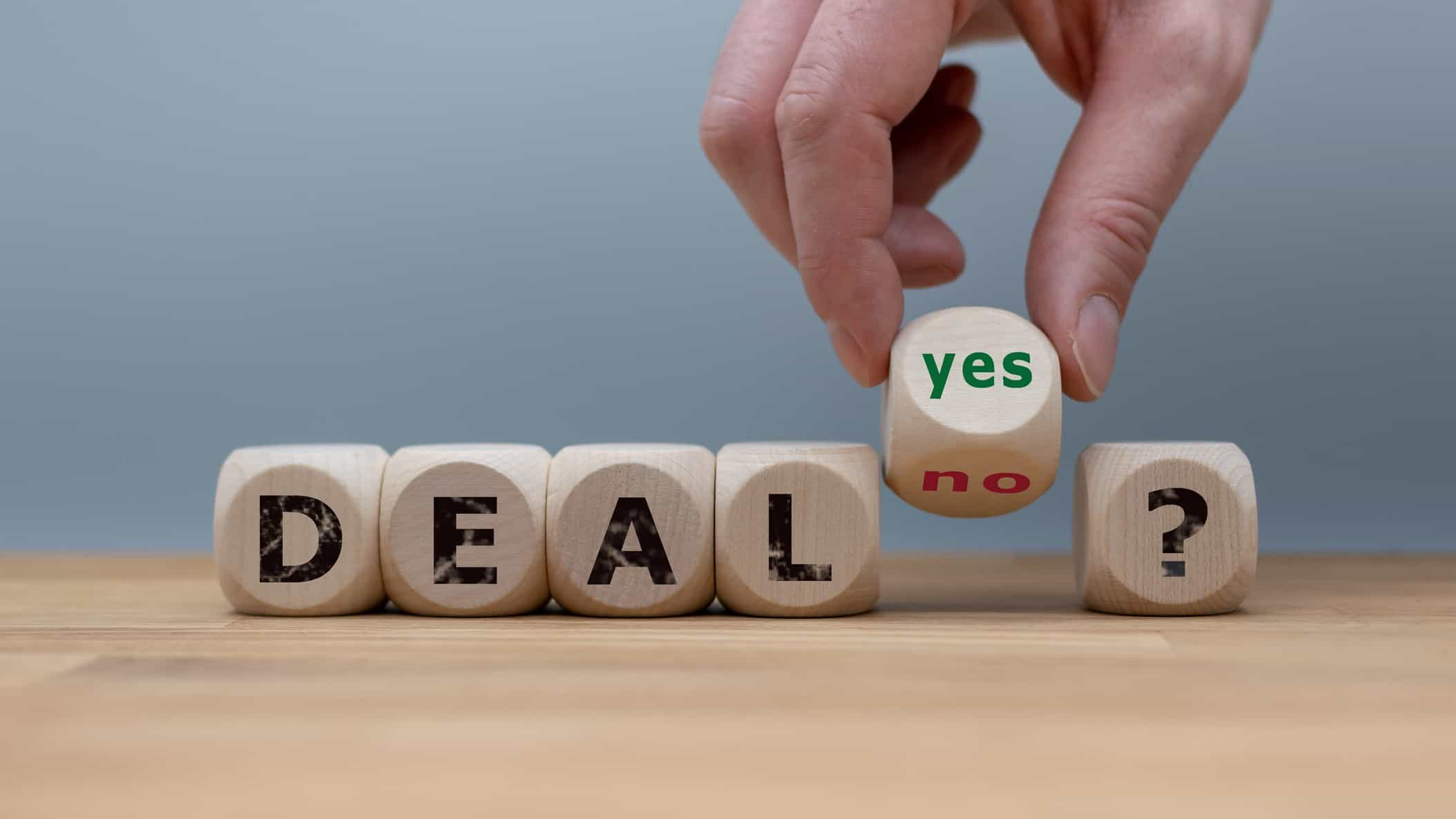wooden blocks spelling deal with one block saying yes and no representing wesfarmers share price