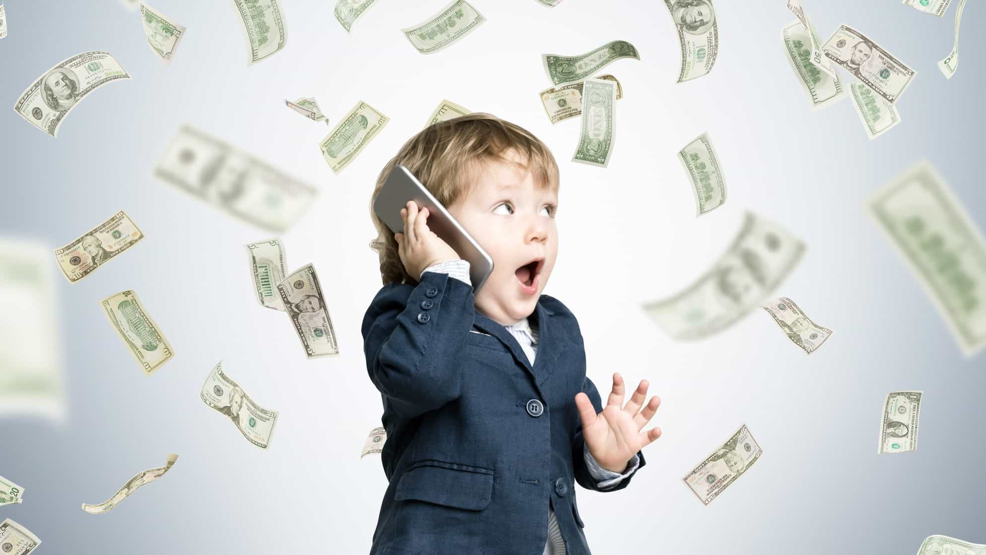 toddler in business attire surrounding by floating money representing asx shares beginner investor